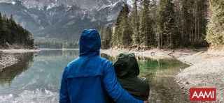 Couple looking at mountain lake