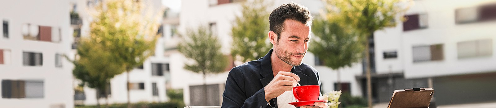 Man sitting at cafe drinking coffee