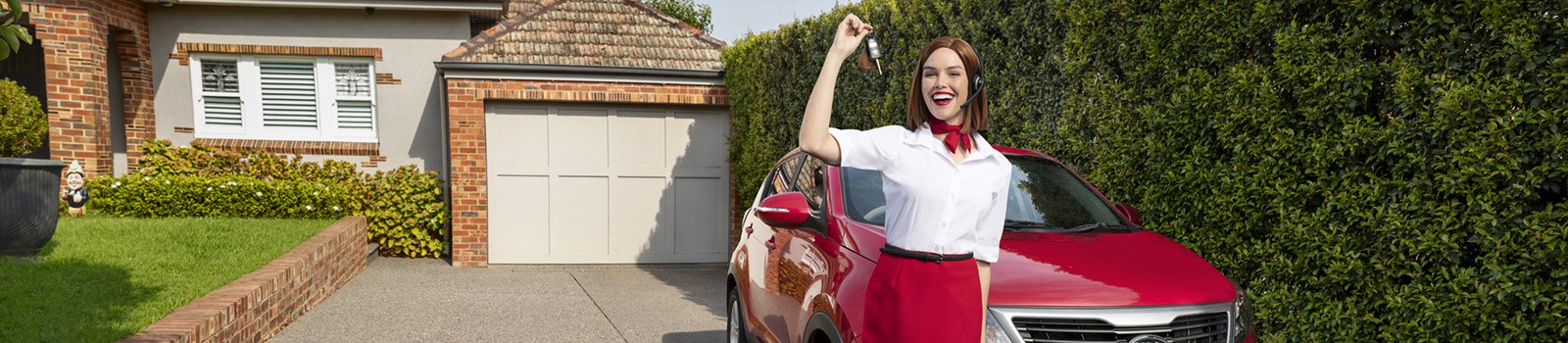 AAMI girl standing next to car in a driveway dangling keys